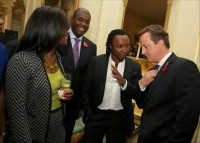 Freddie Achom talking with Former PM David Cameron