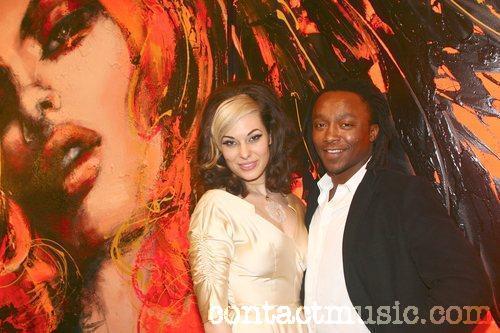 Freddie Achom with Immodesty Blaize